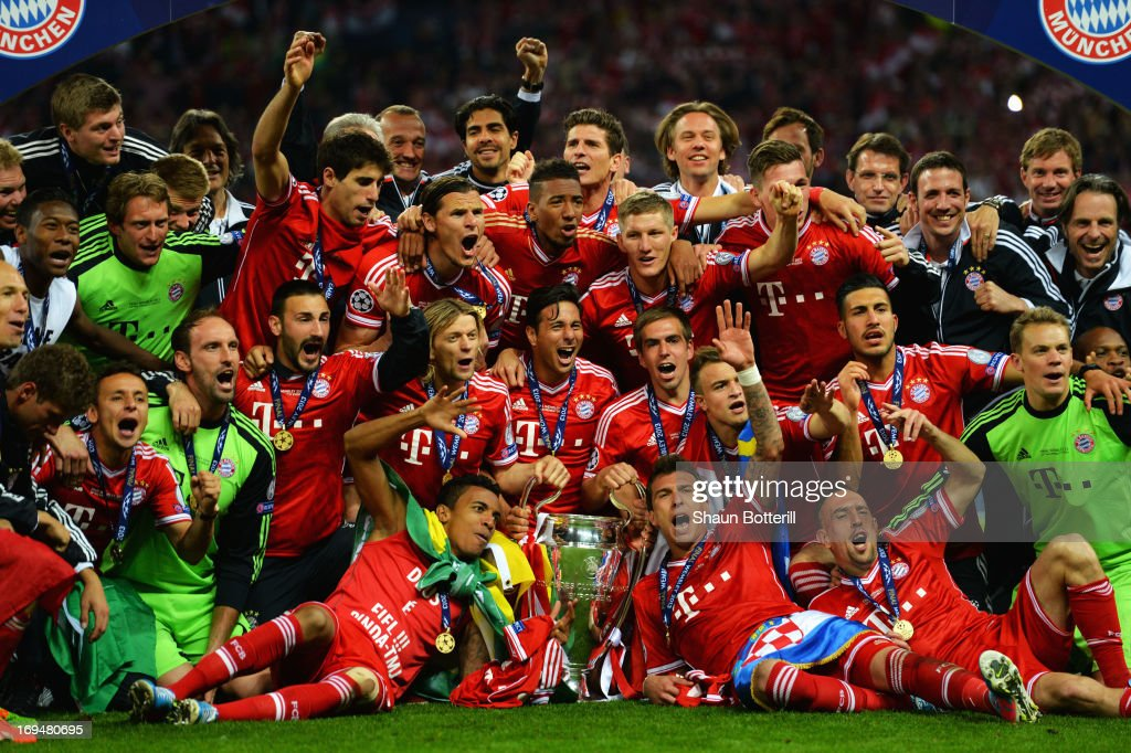 The FC Bayern Muenchen team poses with the trophy after winning the UEFA Champions League final match against Borussia Dortmund at Wembley Stadium on May 25, 2013 in London, United Kingdom.