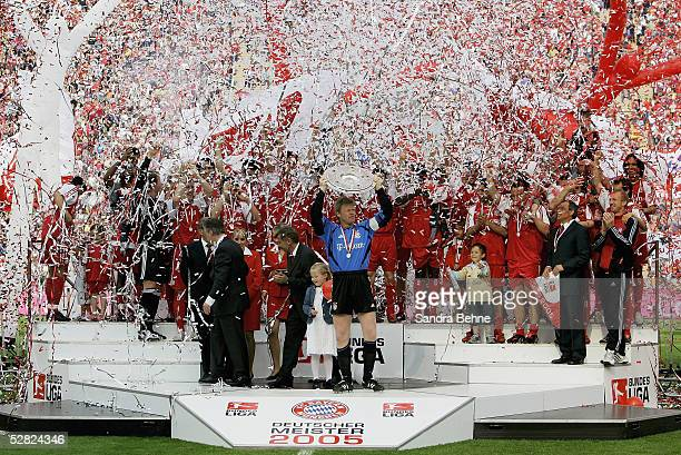 The FC Bayern Munich team celebrate with the trophy after the 1 Bundesliga match between FC Bayern Munich and 1FC Nuremberg at the Olympic Stadium on...
