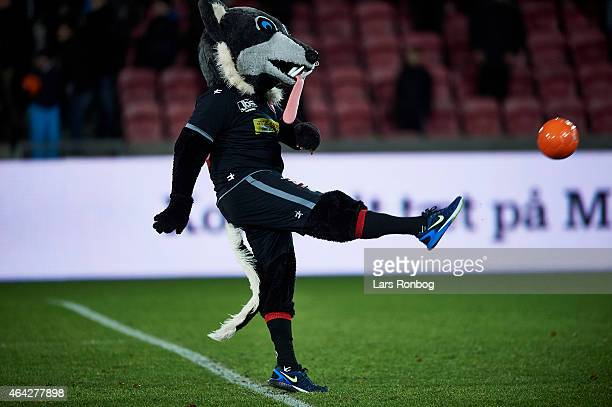 The FC Midtjylland mascot Lupus giving footballs from the Alka sponsor to the fans after the Danish Alka Superliga match between FC Midtjylland and...
