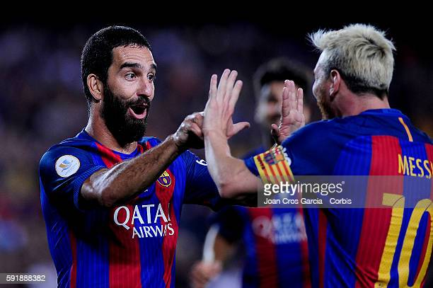 The FCBarcelona players Arda Turan and Lionel Messi celebrating the Arda goal during the FCBarcelona vs Sevilla FC Spanish Super Cup match at Nou...