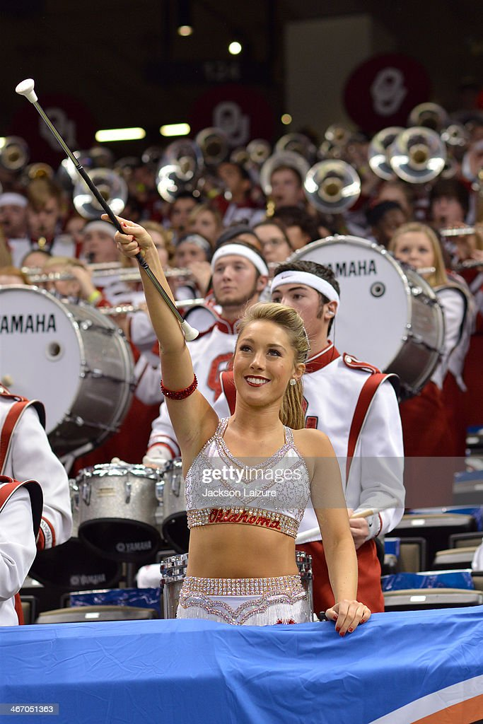 The Feature Twirler of the Oklahoma Sooners marching band The Pride of Oklahoma watches game action during the Sooners' win against the Alabama Crimson Tide in the BCS Sugar Bowl on January 2, 2014 at Mercedes-Benz Superdome New Orleans, Louisiana.