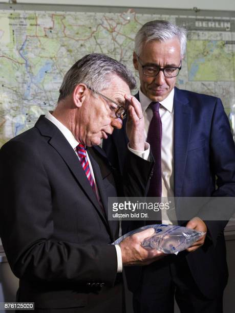 The Federal Interior Minister holds in his hand the bag with soda water for emergency us Federal Interior Minister Thomas de Maiziere presents...