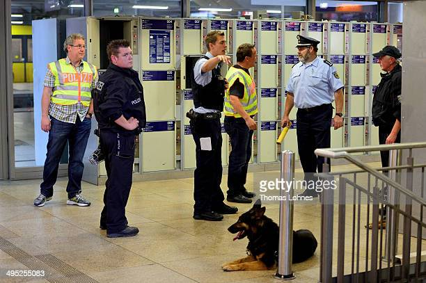 The Federal Police stands in front of lockers and decide to evacuate the main railway station on May 27 2014 in Mainz Germany During antiterrorism...