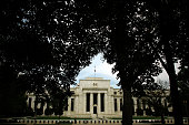 The Federal Reserve can be seen from in between trees on the National Mall September 16 2008 in Washington DC The Federal Open Market Committee met...