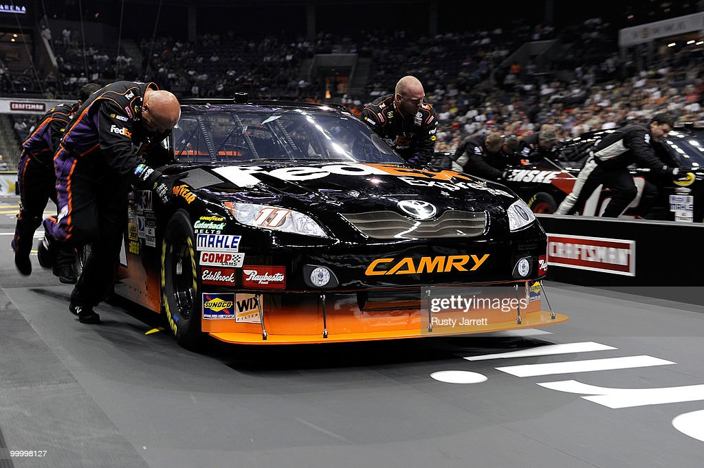 The #11 FedEx Freight Toyota defeat the #12 Penske Dodge pit crew to move on to the quarter-finals during the NASCAR Sprint Pit Crew Challenge at Time Warner Cable Arena on May 19, 2010 in Charlotte, North Carolina.