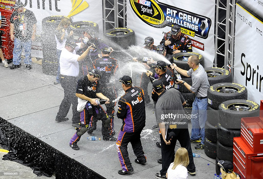 The #11 FedEx Freight Toyota pit crew celebrate after defeating the #31 Caterpillar Chevrolet pit crew in the finals of the NASCAR Sprint Pit Crew Challenge at Time Warner Cable Arena on May 19, 2010 in Charlotte, North Carolina.