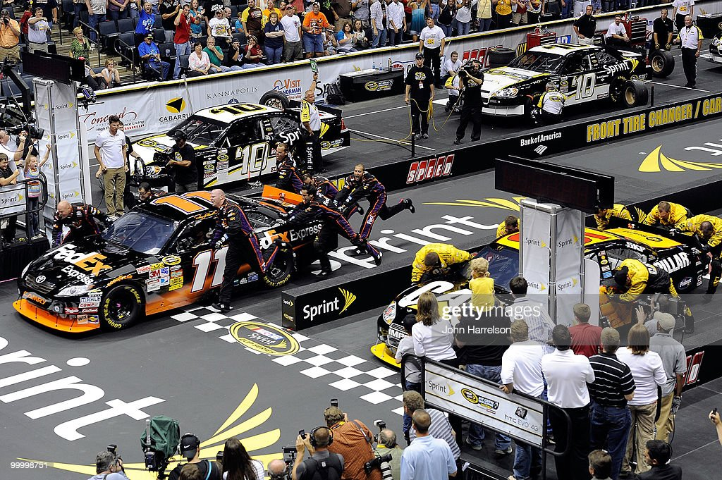 The #11 FedEx Freight Toyota pit crew defeat the #31 Caterpillar Chevrolet pit crew to win the NASCAR Sprint Pit Crew Challenge at Time Warner Cable Arena on May 19, 2010 in Charlotte, North Carolina.