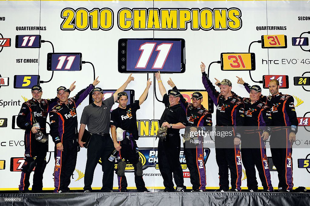 The #11 FedEx Freight Toyota pit crew pose after defeating the #31 Caterpillar Chevrolet pit crew in the finals of the NASCAR Sprint Pit Crew Challenge at Time Warner Cable Arena on May 19, 2010 in Charlotte, North Carolina.