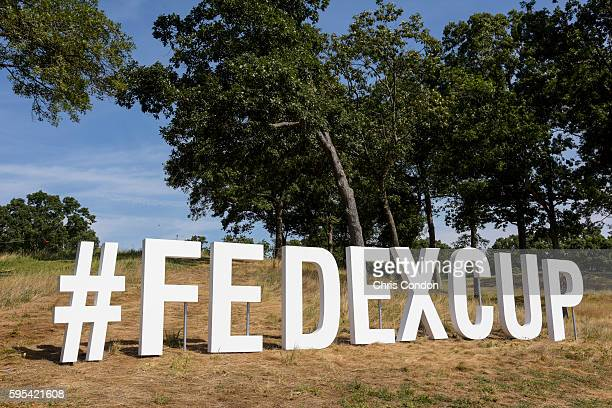 The #FedExCup logo sits on display along the 18th hole during the first round of The Barclays at Bethpage State Park on August 25 2016 in Farmingdale...