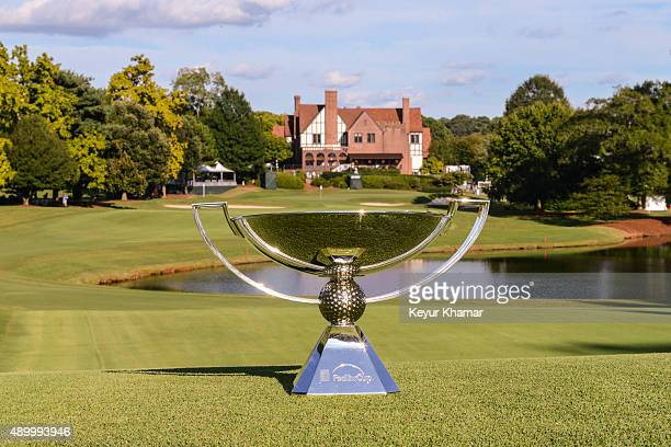 The FedExCup trophy is arranged for a photo on the ninth hole fairway in front of the clubhouse during practice for the TOUR Championship by CocaCola...