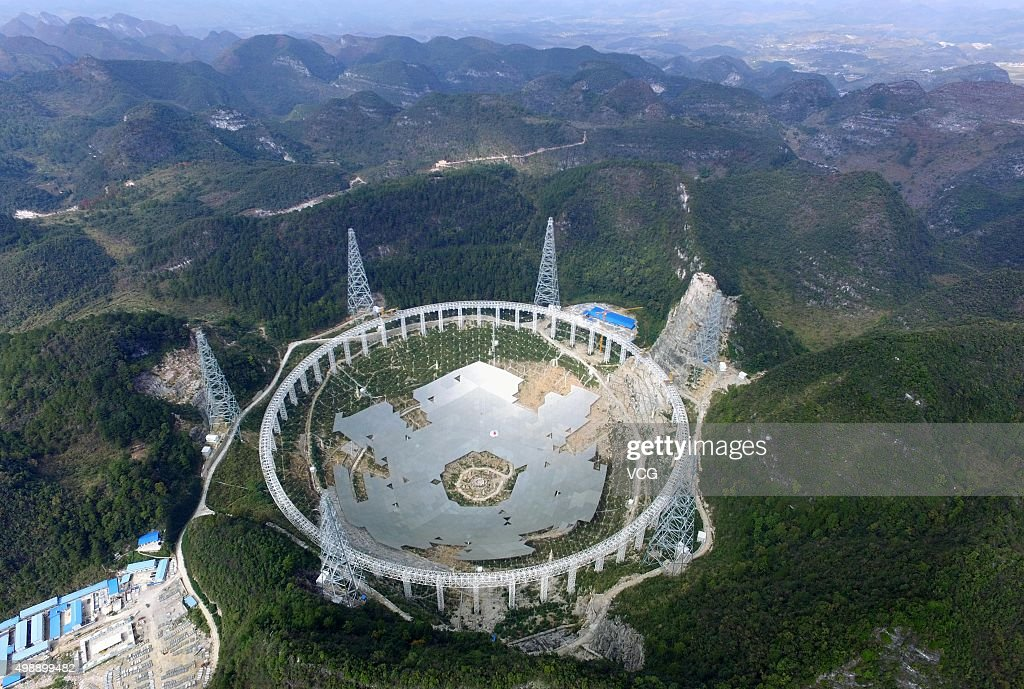 The feed supporting system of the fivehundredmetre Aperture Spherical Radio Telescope is under test on November 26 2015 in Pingtang County China The...