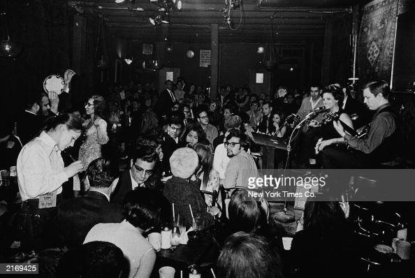 The Feenjon folk group performs on stage for customers at the Feenjon Coffee Shop at 105 MacDougal Street in Greenwich Village New York City 1960s