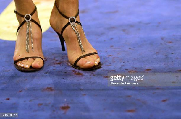 the feet of a numbergirl are seen in the blood of wounded Arthur Abraham after his victory during the IBF World Championship Middleweight fight...
