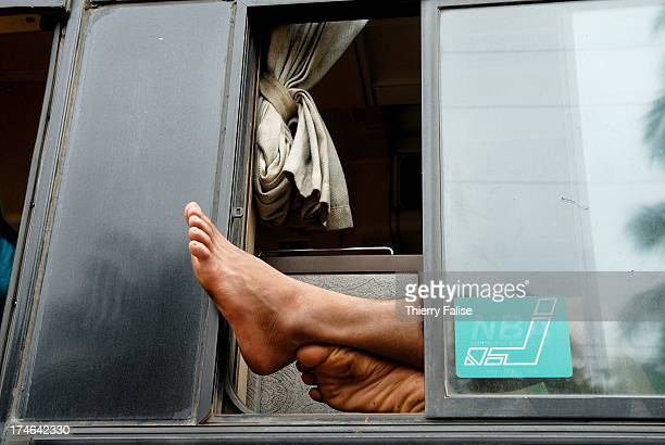 The feet of a sleeping bus driver
