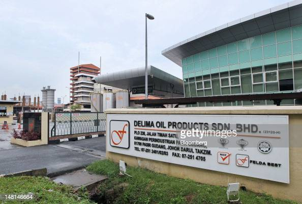 The Felda Global Ventures Holdings Bhd logo is displayed at the entrance to the Delima Oil Products Sdn Bhd refinery a subsidiary of Felda in Pasir...