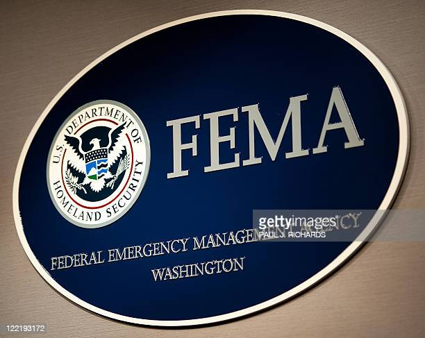 The FEMA logo seen August 26 shortly before a press conference by Homeland Security Secretary Janet Napolitano regading Hurricane Irene at FEMA...