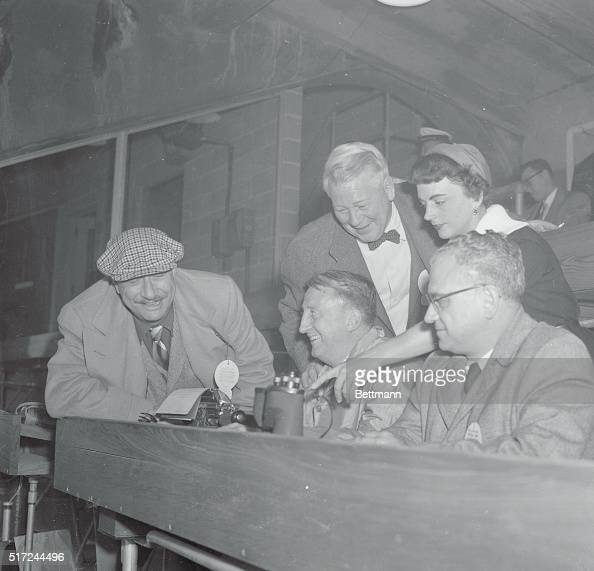 The feminine touch goes to the press box as United Press woman sports writer Faye Loyd joins her male colleagues in reporting the football game...