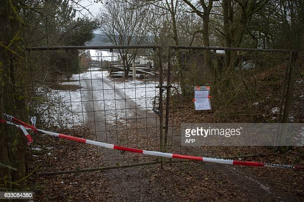 The fence blocking the access to the private property where six teenagers were found dead is pictured in Arnstein central Germany on January 30 2017...