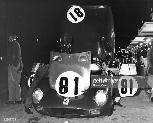 The Ferrari 250LM of David Piper and Masten Gregory gets service on pit road early in the running of the 24 Hours of Daytona at Daytona International...