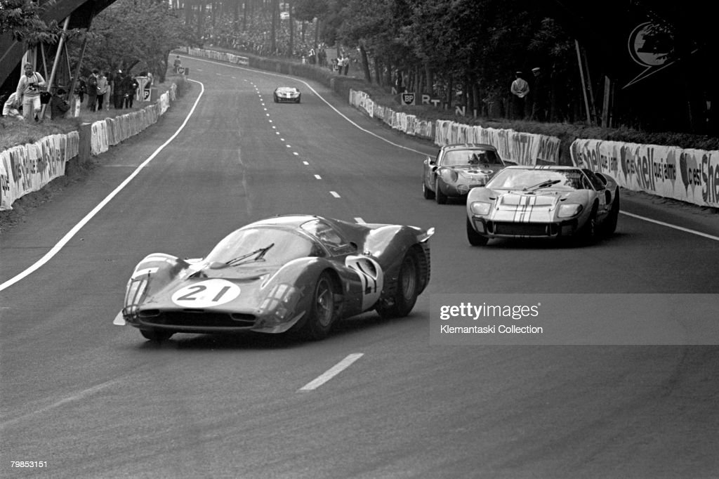 The Ferrari 330P3 of Lorenzo Bandini and Jean Guichet leading the Ford GT40 Mk II of Denis Hiulme and Ken Miles through Tertre Rouge during The 24...