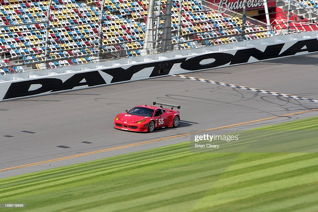 The #55 Ferrari 458 of Michael Waltrip, Robert Kauffman, Clint Bowyer and Rui Aguas is driven during preseason testing at Daytona International Speedway on January 5, 2013 in Daytona Beach, Florida.