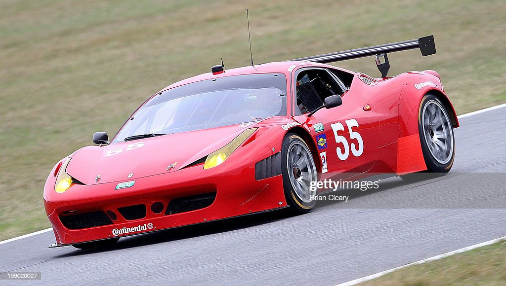 The #55 Ferrari 458 of <a gi-track='captionPersonalityLinkClicked' href=/galleries/search?phrase=Michael+Waltrip&family=editorial&specificpeople=204621 ng-click='$event.stopPropagation()'>Michael Waltrip</a>, Robert Kauffman, <a gi-track='captionPersonalityLinkClicked' href=/galleries/search?phrase=Clint+Bowyer&family=editorial&specificpeople=537951 ng-click='$event.stopPropagation()'>Clint Bowyer</a> and Rui Aguas is driven during preseason testing at Daytona International Speedway on January 5, 2013 in Daytona Beach, Florida.