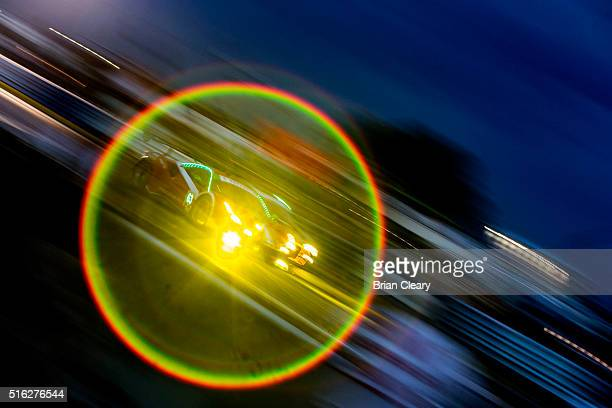 The Ferrari of Christina Nielsen Alessandro Balzan and Jeff Segal is framed by lens light flare as it races on the track during night practice for...