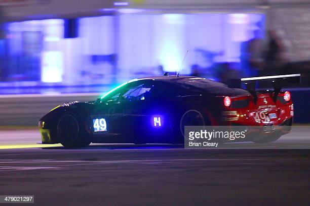 The Ferrari of Gialuca Roda and Paolo Ruberti is shown in action at night during the 12 Hours of Sebring at Sebring International Raceway on March 15...