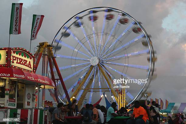 The ferris wheel is seen during the first day of the MiamiDade County Youth Fair at Tamiami Park on March 12 2015 in Miami Florida The fair is...