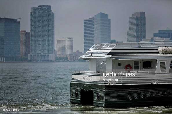 The ferry 'Jersey' takes Goldman Sachs Group Inc workers across the Hudson River to New Jersey from Battery Park in New York US on Wednesday May 29...