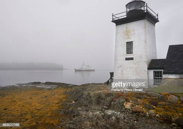 The ferry Margaret Chase Smith makes its way past Grindle Point Light in fog on Islesboro on Tuesday May 2 2017 Residents of Islesboro are divided...
