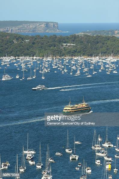 The ferry 'Narrabeen' heads past spectator craft on route to Manly from Circular Quay on New Year's Eve on Sydney Harbour on December 31 2015 in...