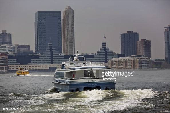 The ferry 'York' takes Goldman Sachs Group Inc workers across the Hudson River to New Jersey from Battery Park in New York US on Wednesday May 29...