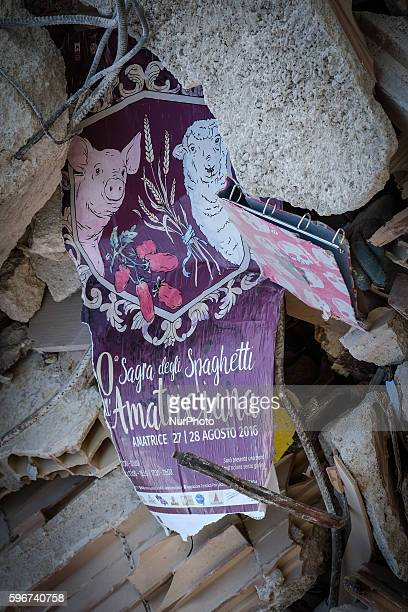The festival of 'Spaghetti Amatriciana' was to be held on 27 and 28 August 2016 the poster found in the ruins of a building destroyed by the massive...