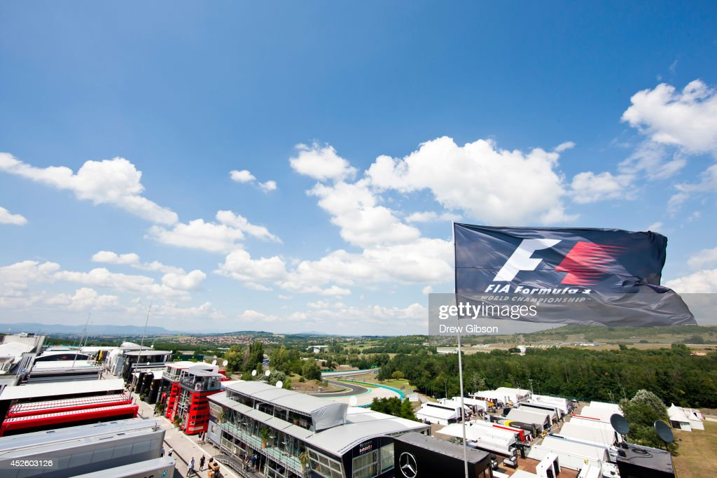 The FIA flag flaps in the wind above the paddock during previews ahead of the Hungarian Formula One Grand Prix at Hungaroring on July 24 2014 in...