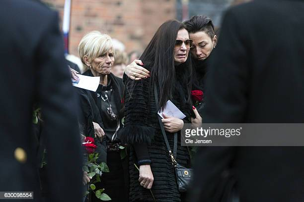 The fiancée after the murdered Danish police officer Jesper Jul receives a state funeral at Roskilde Cathedral on December 16 2016 in Roskilde...