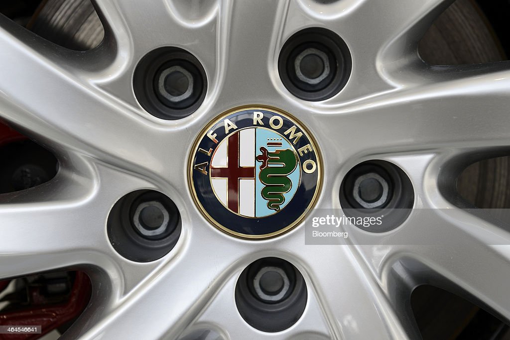 The Fiat SpA Alfa Romeo logo is displayed on the hubcap of a Giulietta automobile inside a GST Co showroom in Tokyo Japan on Wednesday Jan 22 2014...