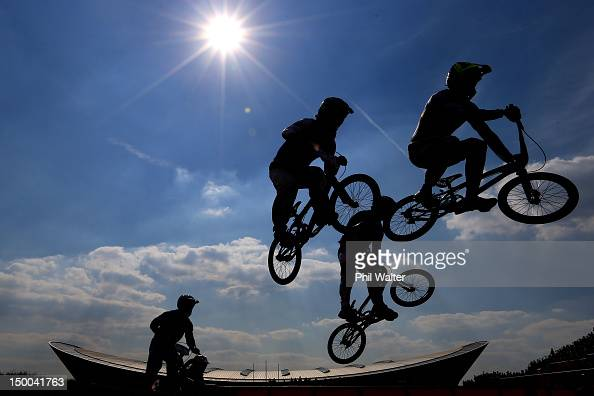 The field clear a jump during the Men's BMX Cycling Quarter Finals on Day 13 of the London 2012 Olympic Games at BMX Track on August 9 2012 in London...
