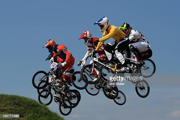 The field clear a jump in the Men's BMX Cycling Semi Finals on Day 14 of the London 2012 Olympic Games at the BMX Track on August 10 2012 in London...