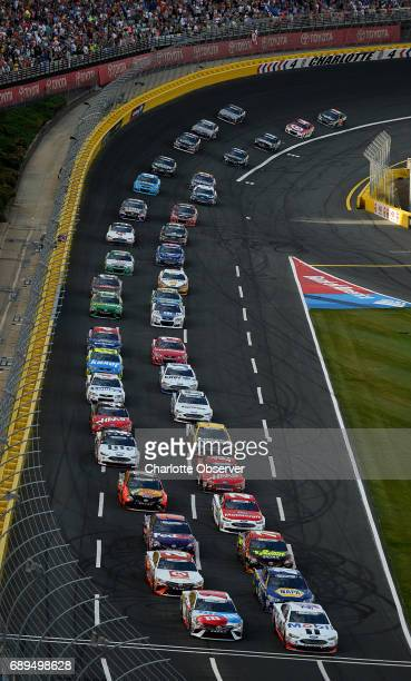 The field for the CocaCola 600 exits Turn 4 and heads down the front stretch at Charlotte Motor Speedway as fans cheer on Sunday May 28 2018