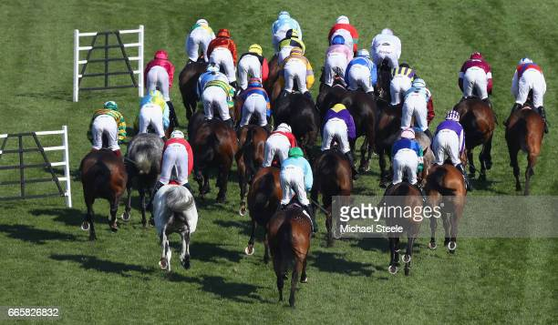 The field head out in the Topham Handicap Steeplechase during Ladies Day on day two of the Randox Health Grand National meeting at Aintree Racecourse...