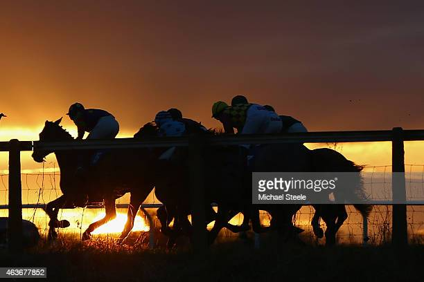 The field head round the back straight during the standard national hunt flat race at Taunton Racecourse on February 17 2015 in Taunton England