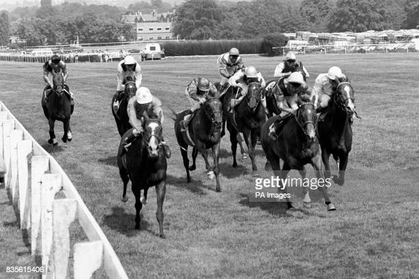 The field heading for the line with eventual winner Sadler's Wells with Pat Eddery up battling for the lead from second placed Time Charter the mount...