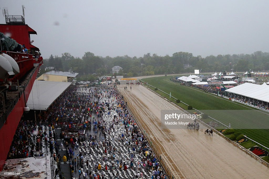 The field heads into the first turn during the 140th running of the Preakness Stakes at Pimlico Race Course on May 16 2015 in Baltimore Maryland