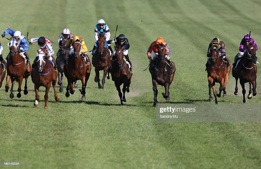 The field in race three gallop down the home straight during the Karaka Million at Ellerslie Racecourse on January 27, 2013 in Auckland, New Zealand.