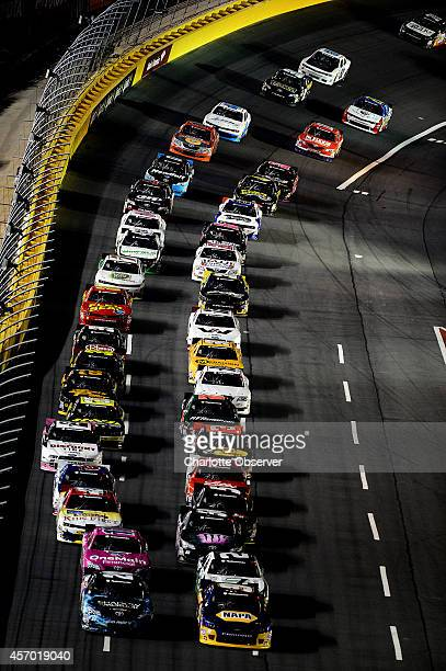 The field in the Drive for the Cure 300 near the start/finish line at Charlotte Motor Speedway in Concord NC on Friday Oct 10 2014