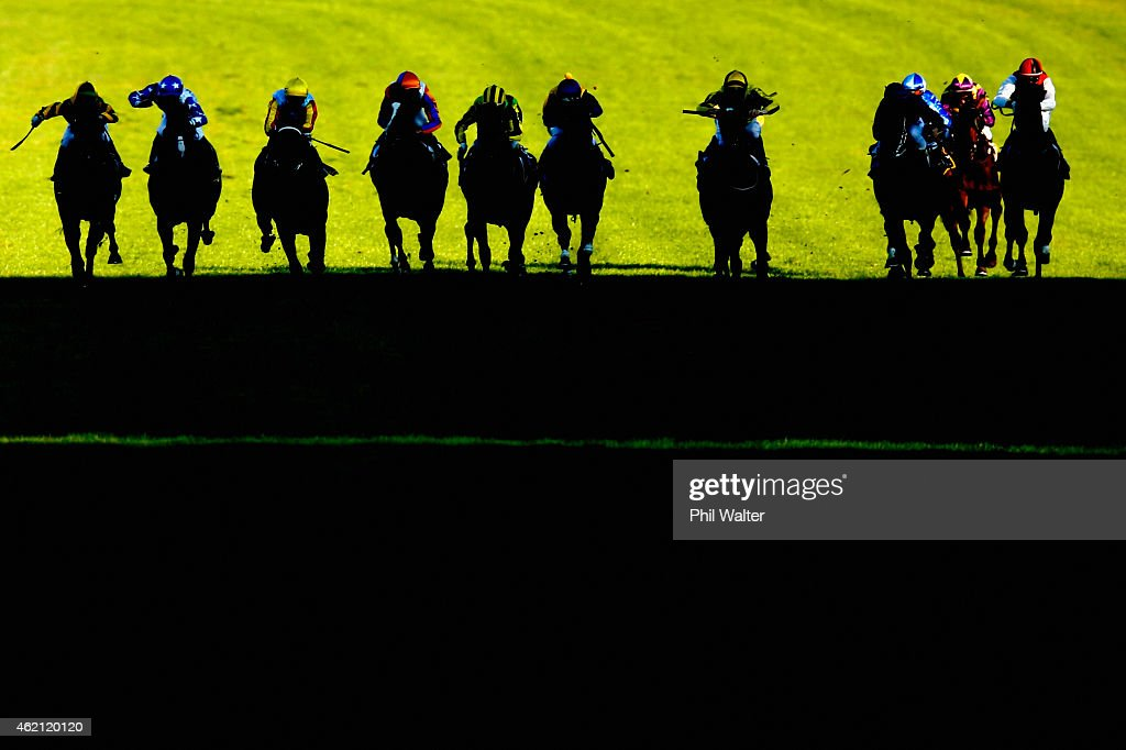 The field in the Karaka Million approach the finish line during the Karaka Million race meet at Ellerslie Racecourse on January 25 2015 in Auckland...