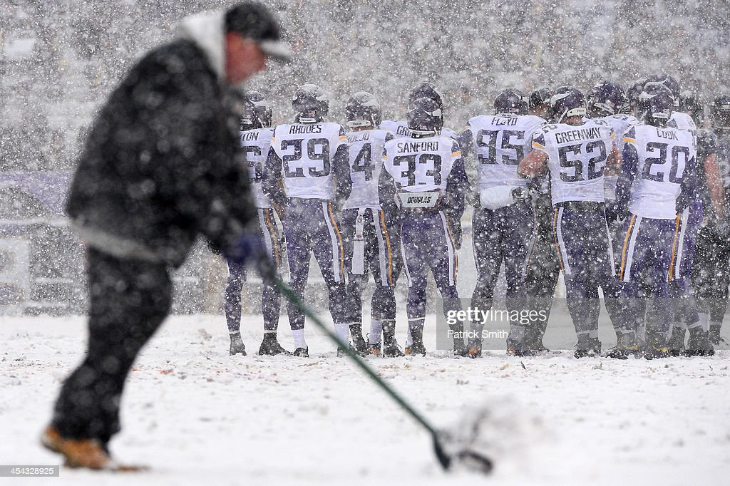 The field is cleared of snow as the Minnesota Vikings huddle up against the Baltimore Ravens in the first quarter at M&T Bank Stadium on December 8, 2013 in Baltimore, Maryland. The Baltimore Ravens won, 29-26.