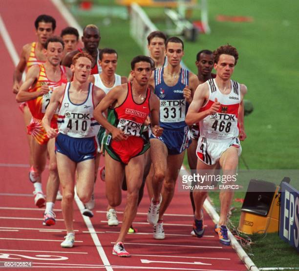 The field is led by Great Britain's John Mayock Morocco's Hicham El Guerrouj and Germany's Rudiger Stenzel as a lap is completed