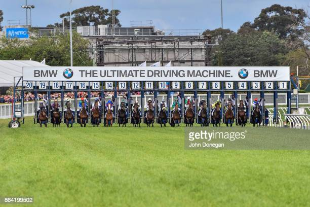 The field leaves the barriers for the BMW Caulfield Cup at Caulfield Racecourse on October 21 2017 in Caulfield Australia